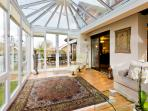 Access to the decking and garden from the conservatory.