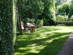 Summer shade in the lawned garden in Pixie Place.