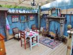 Glamping at its best! Quirky style, wonderful facilities. Kitchen/dining area.