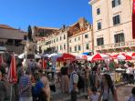 Shop at the green market in the Old Town, a 2-minute walk from Divine