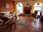 Living room is one of numerous places to gather and relax at Harrier House.
