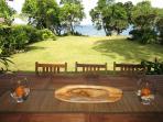 Enjoy your meals on the outdoor balcony overlooking the ocean...