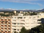 View of snow  capped mountains from balconies