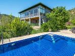 Gorgeous house with private garden and infinity pool and views.