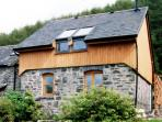 Ty Wennol is a cosy cottage on a farm in the Dyfi Valley near Machynlleth