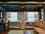 2 private twin beds with drapes to pull closed make great reading nooks or napping spot
