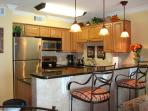 Updated kitchen with granite counters, stainless app., bar lights!
