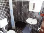 Full bathroom with shower facilities
