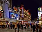 Leicester Square -- within 50 meters, ful of theater and activity