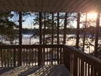 Beautiful sunshine overlooking the lake on the huge deck.