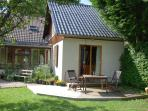 Le Petit Chalet exterior with decking and garden furniture