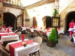Dine in a restaurant like this in Sarlat,with its cobble stone alleys and ochre colored walls