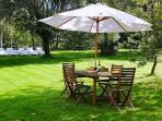 The garden outside Villa MImosa with table and chairs for al fresco dining .