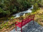 Meditation bench at the end of one of our trails with waterfall on Gumbottom creek below.