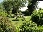 Garden with picnic table - looking away from cottage - swing visable.
