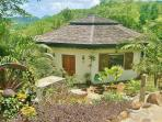 Palm Cottage is surrounded by lush tropical gardens and has the most amazing views