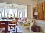 Open concept living room/bedroom combination.