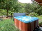 Hot tub.  Just off the outdoor patio and waterfall view