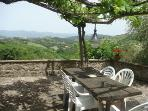 kitchen terrace - under the vine with a unoverlooked and uninterrupted view of the valley.