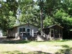 The Cottage offers a peaceful and private deck and screened shelter...