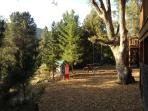 Flat back yard w/ picnic table, swing & playhouse