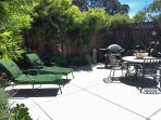 Private fenced yard with gas BBQ and chaise lounges