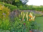 Herbaceous border and view from the front of the house across the Teign valley.