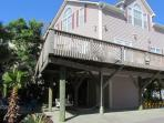 Two Story beach house with plenty of covered parking and a large outdoor ground level area