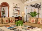 Inside, the semicircular living room has three deep-cushioned sofas, a 43' TV and ...
