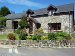 Friendly Cottage is a lovely stone property converted from a former barn in the historic village of Llanarth