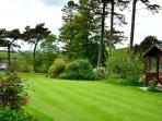 Landscaped garden holds its own summer house, green house and a swimming pool