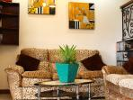 The living room provides a cozy area to socialize, relax, and watch some shows.