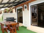 The back patio provides a wonderful outdoor area protected from sun and rain.