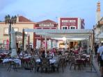 Ferragudo square early in the evening, with a huge selection of places for eating out.