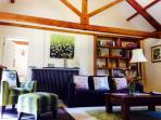 The living room - huge exposed oak beams & chandeliers rise above you...