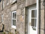 Peters is a traditional granite Cornish cottage looking across to the coastal path and the sea.