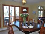 Formal Dining area links with grilling deck, kitchen and Great room in open layout