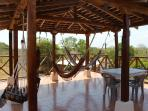 Grab a book, pick a hammock and relax in this beautiful bohio!