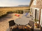Our large beachside deck, with great sand play area for the kids & Patio Set