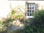 The cottage is surrounded by rolling hills, lovely vast fields and flowers.
