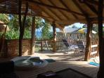 View of the sunbathing deck, plunge pool and the beach beyond
