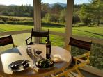 Relax over a leisurely dinner gazing over the pond to the White Mountains in the distance
