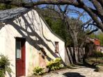 Side patio of Carriage House with 100 yr. old pecan tree!