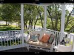 Screened in porch with wicker furnishings for a good book to read