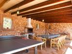 Outdoor dining area with table tennis
