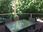 The Maple treetops provide a beautiful backdrop for this extendable outdoor setting.