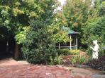 The rotunda in our garden is just visible through the Maples at the back of our 470 m2 block
