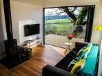 Living space, with bifold doors to decked area