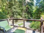 Cottage porch: a quiet place to enjoy the redwoods and seasonal creek