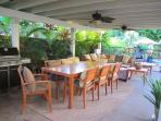 Under our covered lanai, 1 of 2 outdoor dining tables in our backyard with seating for eight each.